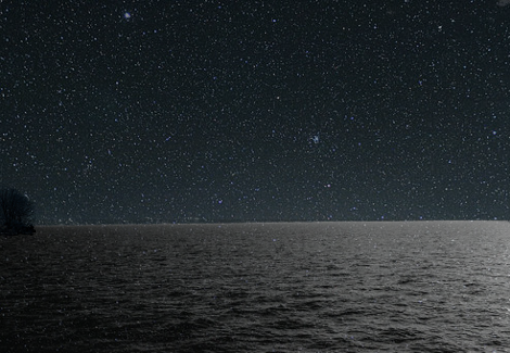 a calm ocean at night
